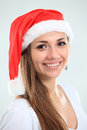 Pretty christmas girl in santa hat Royalty Free Stock Image