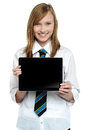 Pretty college girl displaying a tablet device Stock Images