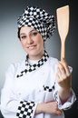 Pretty cook with kitchen utensils Royalty Free Stock Photography
