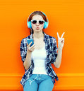 Pretty cool girl having fun and listens to music Royalty Free Stock Photo