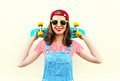 Pretty cool smiling woman with skateboard over white Royalty Free Stock Photo