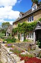 Pretty cottages lower slaughter stone in the centre of the village cotswolds gloucestershire england uk western europe Stock Image
