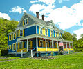 Pretty country home colorful blue and yellow Royalty Free Stock Photo