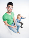 Pretty couple dressed casual arguing wide angle shot view from above Stock Image