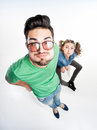 Pretty couple dressed casual making funny faces view from above wide angle shot Stock Images