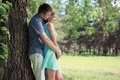 Pretty couple resting in sunny summer park love relationships concept Royalty Free Stock Images