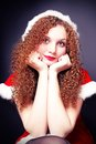 Pretty curly girl in a Santa suit Stock Photo
