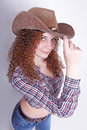 Pretty curly sexy cowboy girl Royalty Free Stock Photography
