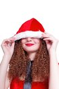 Pretty curly snow maiden hiding  Christmas Royalty Free Stock Photography