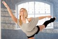 Pretty dancer practicing female lifting leg Royalty Free Stock Photo