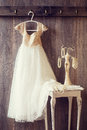 Pretty dress and table with pearl jewellery vintage tone effect Royalty Free Stock Photo