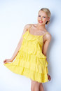 Pretty elegant woman wearing yellow dress Royalty Free Stock Image
