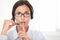 Pretty employee speaking on the headset in blue shirt while shushing and looking at you copyspace Royalty Free Stock Image