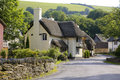 Pretty exmoor house thatched cottage in a small village in somerset Royalty Free Stock Image