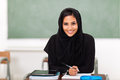 Pretty female arabian high school student classroom Stock Photography