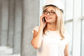 Pretty female architect talking on phone Royalty Free Stock Photo