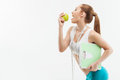 Pretty female athlete with fruit and balance Royalty Free Stock Photo