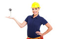 Pretty female cctv installer presenting camera white background Royalty Free Stock Photography