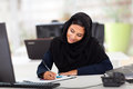 Pretty female middle eastern office worker working modern office Royalty Free Stock Images