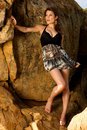 Pretty female model standing on the rocks Royalty Free Stock Photography