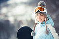 Pretty female snowboarder Stock Photos