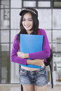 Pretty female student smiling at the camera Royalty Free Stock Photo