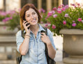 Pretty Female Student Walking Outside Using Cell Phone Royalty Free Stock Images