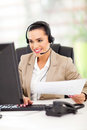Pretty female telemarketer headphones working office Stock Image