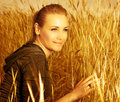 Pretty female on wheat field Royalty Free Stock Images