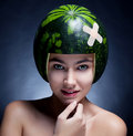 Pretty femalein helmet of ripe watermelon Royalty Free Stock Image