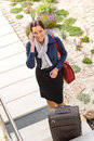 Pretty filght attendant leaving calling luggage phone Stock Images