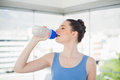 Pretty fit woman drinking water on her plastic flask Royalty Free Stock Photo