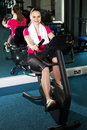 Pretty fit woman pedaling exercise bike fast Royalty Free Stock Photography