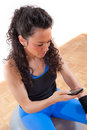 Pretty fitness girl taking a break with cellphone Stock Images