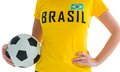 Pretty football fan in brasil t shirt on white background Stock Photos