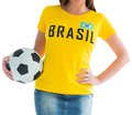 Pretty football fan in brasil t shirt on white background Royalty Free Stock Photo