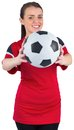 Pretty football fan in red on white background Royalty Free Stock Image