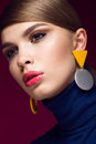 Pretty fresh girl fashionable image of modern twiggy with unusual eyelashes and bright accessories photos shot in studio Royalty Free Stock Photography