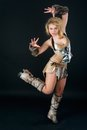 Pretty funny barbarian girl young beautiful woman in costume at black background Royalty Free Stock Image