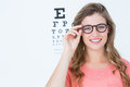 Pretty geeky hipster with glasses and eye test Royalty Free Stock Photo