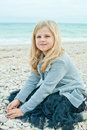 Pretty girl at the autumn beach little Royalty Free Stock Photography
