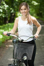 Pretty girl with a bicycle Royalty Free Stock Photo