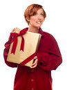Pretty Girl Biting Lip Holding Wrapped Gift Royalty Free Stock Image