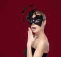 Pretty girl with black masquerade mask Stock Images