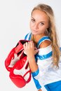 Pretty girl with boxing gloves young blonde woman at white background Royalty Free Stock Photo