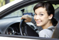 Pretty girl in a car smiling Royalty Free Stock Photo