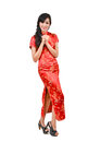 Pretty girl with cheongsam wishing you a happy Chinese new year Stock Photography