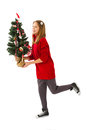 Pretty girl with christmas tree last minute Royalty Free Stock Photography
