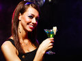 Pretty girl with a drink happy beautiful in nightclub Stock Photo