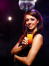 Pretty girl with a drink happy beautiful in nightclub Royalty Free Stock Image